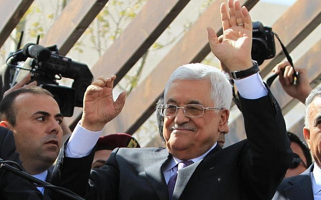 Palestinian Authority President Mahmoud Abbas greets his supporters following a trip to Washington DC, on March 20, 2014, in the West Bank city of Ramallah. (Issam Rimawi/Flash90)