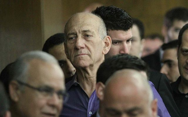 Former prime minister Ehud Olmert in Tel Aviv District Court, March 31, 2014, where he was found guilty of bribe-taking in the Holyland real estate scandal. (photo credit: Ido Erez/Pool/Flash90