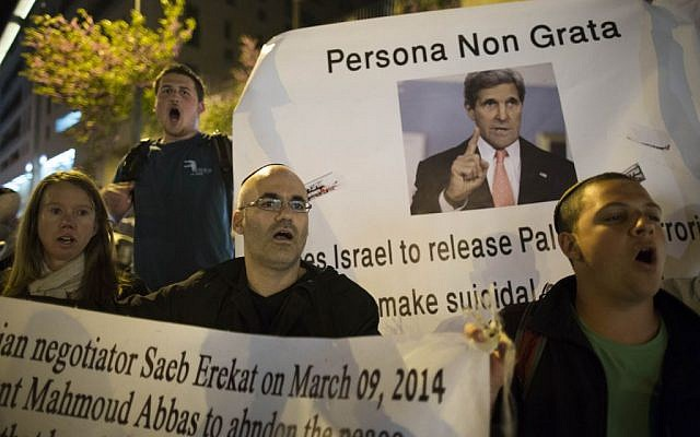 Israelis protesting Kerry's visit outside the David Citadel hotel in Jerusalem, March 31, 2014 (photo credit: Yonatan Sindel/Flash90)