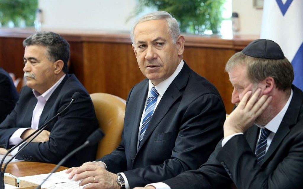 Prime Minister Benjamin Netanyahu, center, is seen at a cabinet meeting at the PMO in Jerusalem, April 6, 2014 (photo credit: Amit Shabi/Flash90/Pool)