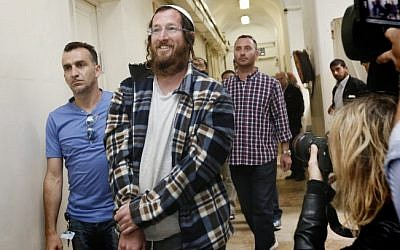 One of the Jewish settlers arrested for destroying an IDF outpost in the Israel settlement of Yitzhar is brought to the Tel Aviv Magistrate's Court on April 10, 2014. (photo credit: Miriam Alster/FLASH90)