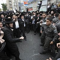 Illustrative: Hundreds of ultra-Orthodox Jews clash with Israeli police during a protest in Jerusalem on April 10, 2014, following the arrest of a Haredi draft-dodger. (Yonatan Sindel/Flash90)