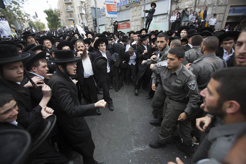 Hundreds of Ultra-Orthodox Jews clash with Israeli police during a protest in Jerusalem on April 10, 2014, following the arrest of a haredi draft-dodger and against a bill intended to enforce the haredi enlistment into the IDF  (Photo credit: Yonatan Sindel/Flash90)