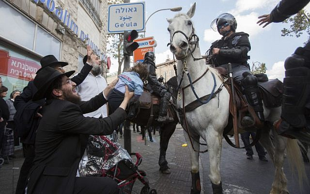Hundreds of ultra-Orthodox Jews clash with police during a protest following the arrest of a draft-dodger, Jerusalem, April 10, 2014. (photo credit: Yonatan Sindel/Flash90)