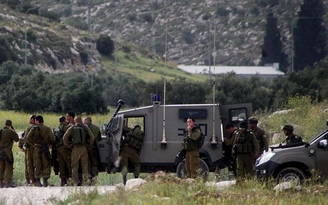 Illustrative: Israeli troops on alert in the West Bank following a fatal shooting attack on Passover eve on Route 35, near Hebron, Tuesday, April 15, 2014. (photo credit: Issam Rimawi/Flash90)