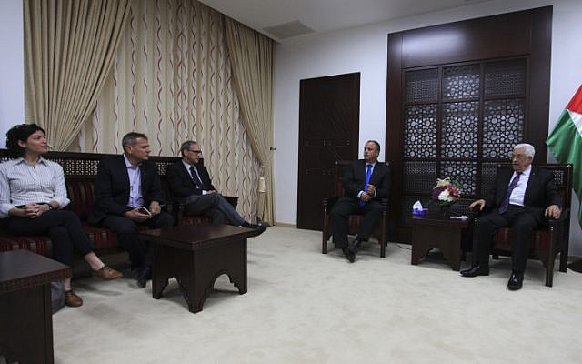 President of the Palestinian Authority Mahmoud Abbas (R) meets with Israeli parliament members in the West Bank city of Ramallah on April 16, 2014. (photo credit: Issam Rimawi/Flash90)
