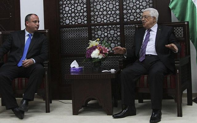 Palestinian Authority President Mahmoud Abbas meets with Israeli MK Hilik Bar in the West Bank city of Ramallah on April 16, 2014. (Photo credit: Issam Rimawi/Flash90)