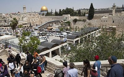 The Western Wall plaza with the Temple Mount in the background, as thousands of visitors arrive in the Old City of Jerusalem during the Jewish holiday of Passover, April 16, 2014. (photo credit: Flash90)