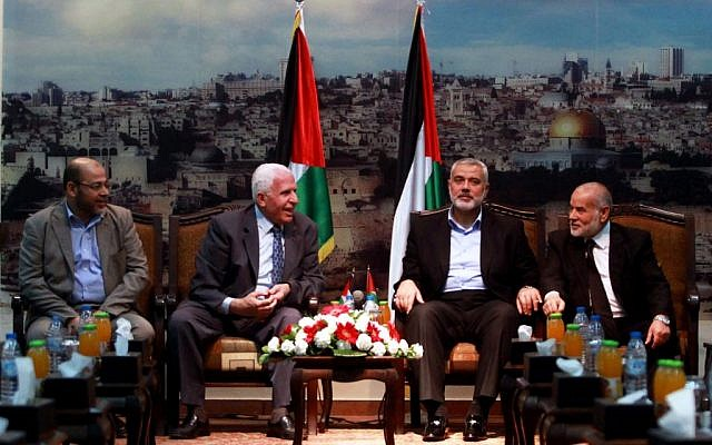 Senior Hamas leader Moussa Abu Marzouk (left) senior Fatah official Azzam Al-Ahmad (second left), head of the Hamas government Ismail Haniyeh (second right) and deputy speaker of the Palestinian Parliament Ahmed Bahar (right) attend a meting in Gaza City on April 22, 2014. (photo credit: Abed Rahim Khatib/Flash90)