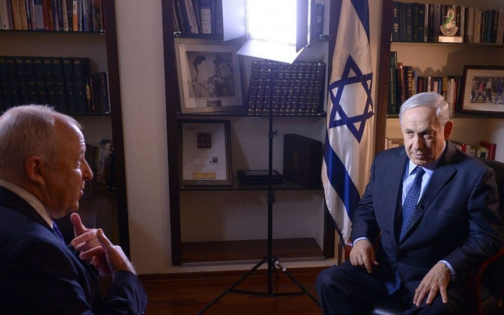 Prime Minister Benjamin Netanyahu (right) speaks to the international media after the announcement of a Fatah-Hamas reconciliation pact, Thursday, April 24, 2014. (photo credit: Haim Zach/GPO/Flash90)