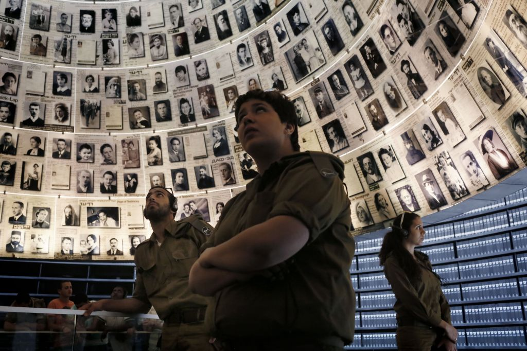 Israeli soldiers look around the 'Hall of Names' during a visit to Yad Vashem several days before Holocaust Remembrance Day (Photo credit: Miriam Alster/Flash 90)