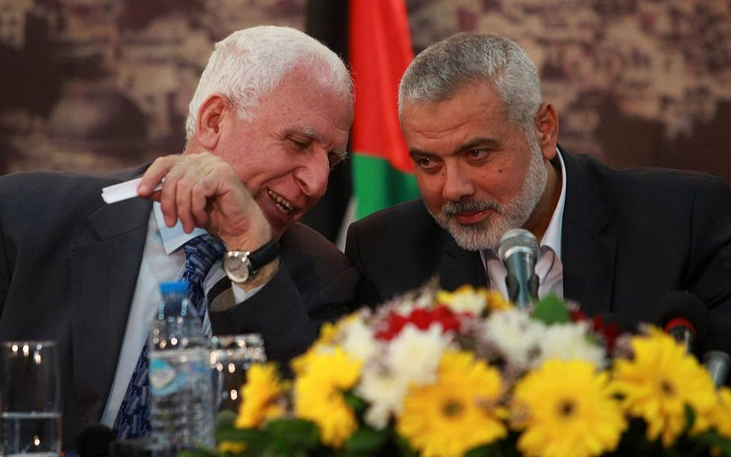Head of the Hamas government Ismail Haniyeh (right) and senior Fatah official Azzam al-Ahmad (left) attend a news conference as they announce a reconciliation agreement in Gaza, on April 23, 2014. (Abed Rahim Khatib/Flash90)