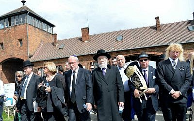 The Israeli delegation, led by Rabbi Meir Lau and chief justice of the Supreme Court Asher Gronis, walk through the entrance of Auschwitz death camp in Poland, as they participate in the March of the Living on April 28, 2014. (photo credit: Yossi Zeliger/FLASH90)