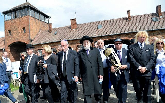 On the right path. Participants march from Auschwitz to Birkenau in the March of the Living in Poland on Monday. Leading the March are Supreme Court Justice Asher Gronis (center left) and former chief rabbi of Yisrael Meir Lau (center right) march of the living in Poland (photo credit: Yossi Zeliger/FLASH90)