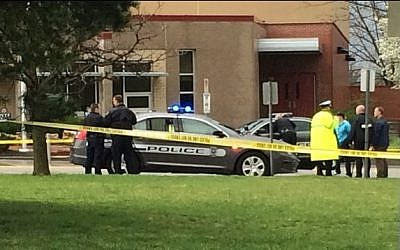 In this photo provided by KSHB41 Action News, authorities respond to the Jewish community center after a shooting in Overland Park, Kan., Sunday, April 13, 2014. (photo credit: AP Photo/KSHB41 Action News)