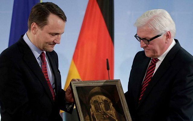 German Foreign Minister Frank-Walter Steinmeier, right, hands over the painting 'Palace Stairs' by 18th-century Venetian artist Francesco Guardi to his counterpart from Poland Radoslaw Sikorski, left, during a ceremony at the Foreign Ministry in Berlin, Germany, Monday, March 31, 2014. (AP Photo/Michael Sohn)