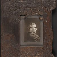 Portrait of Horatio Gates Spafford (1828-1888), poet, philosopher, biblical scholar and lawyer, c. 1860-1888, set in a frame of engraved and glazed olive wood, with images of a sheltering tree, a river and the house on a wall — the first home of the American Colony in the Old City of Jerusalem (Library of Congress, 2005/Courtesy American Colony Archive Collections)