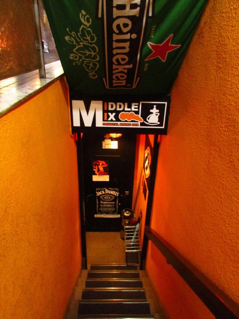 Down a steep flight of steps, you'll find the basement bar. (photo credit: Debra Kamin/Times of Israel)
