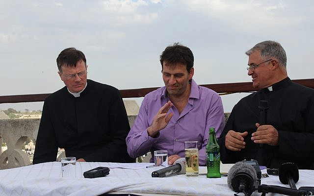 Father Eamon Kelly, L.C., left, Amir Halevi, center, and Father Juan María Solana, L.C., discuss preparations for Pope Francis' Middle East trip in May during a briefing at the Pontifical Institute Notre Dame of Jerusalem Center (photo credit: Rebecca McKinsey/Times of Israel)