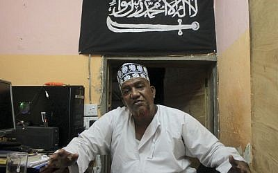 Abubakar Shariff Ahmed sits in his office in Mombasa, Kenya, on Oct. 29, 2013 (photo credit: AP/Jason Straziuso)