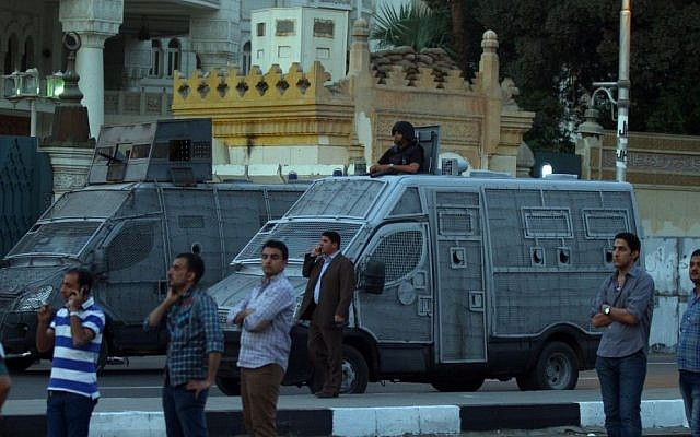 Police block the road in front of the presidential palace in Cairo, Egypt, on Saturday, April 26, 2014. (photo credit: AP)