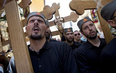 Serbian pilgrims carry crosses during Good Friday in Jerusalem on Friday, April 18, 2014, as Christians commemorated the crucifixion of Jesus. (photo credit: AP/Dusan Vranic)