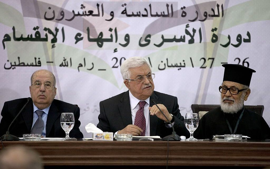 Palestinian Authority President Mahmoud Abbas speaks during a meeting of the Palestinian Central Council, a top decision-making body, at his headquarters in the West Bank city of Ramallah, Saturday, April 26, 2014. Abbas said any unity government with the Islamic extremist Hamas would follow his political program, an apparent attempt to reassure the West. Israel's leaders have accused Abbas of choosing Hamas over possible peace with Israel. (photo credit: AP Photo/Majdi Mohammed)