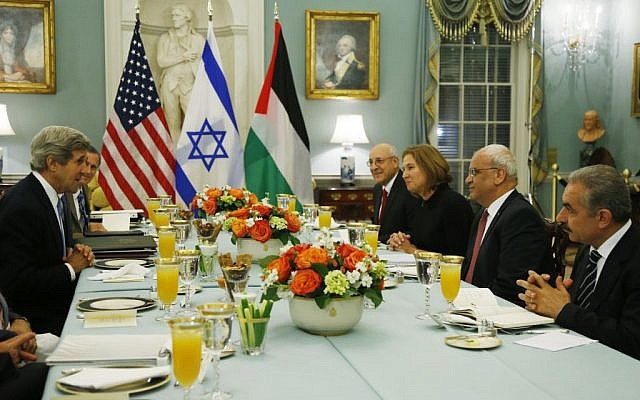 In this July 29, 2013 file photo, Secretary of State John Kerry, left, sits across from Israeli and Palestinian negotiators at the State Department in Washington. (AP/Charles Dharapak, File)