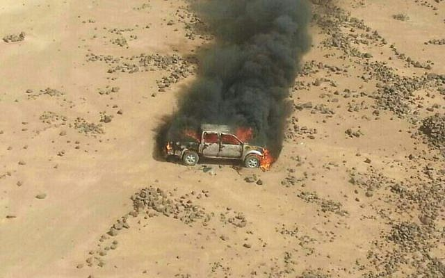 This aerial photo shows a truck burning after a Jordanian air strike on a convoy at the border between Jordan and Syria on Wednesday, April 16, 2014. ( Photo credit: AP/Ammonnews)