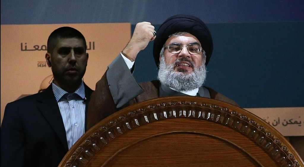In this August 2, 2013 file photo, Hezbollah leader Sheikh Hassan Nasrallah speaks during a rally to mark Jerusalem day, or Al-Quds day, in the southern suburb of Beirut, Lebanon. (AP Photo/Hussein Malla)