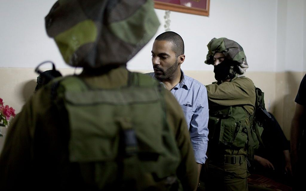 American director James Adolphus directs actors dressed in Israeli army uniforms at the filming location of his movie in the West Bank city of Nablus. (photo credit: AP/The Warren Film)