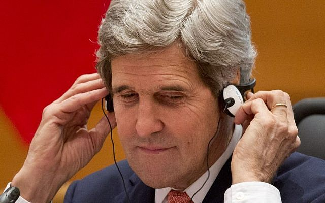 John Kerry puts on translation headphones while attending a US-Morocco Strategic Dialogue opening plenary session at the Ministry of Foreign Affairs in Rabat, Morocco Friday April 4, 2014. (photo credit: AP/Jacquelyn Martin, Pool)