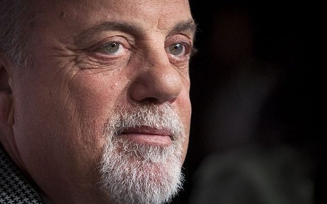 "This Oct. 15, 2013 file photo shows Billy Joel at the Elton John AIDS Foundation's 12th Annual ""An Enduring Vision"" benefit gala in New York, NY (photo credit: AP/Carlo Allegri/Invision)"