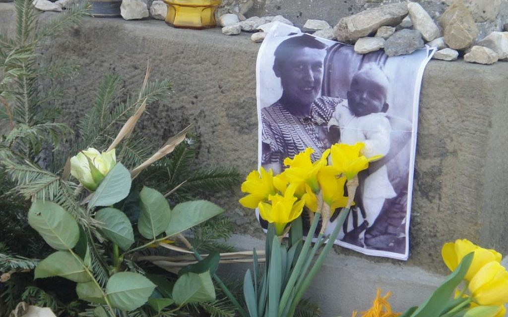 Photo of Janet's mother holding her as an infant -- left at makeshift memorial at Plaszow (courtesy Steve Maas)