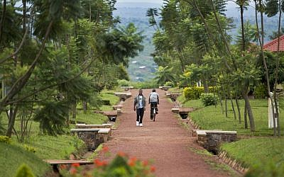 In this photo taken Monday, March 24, 2014, a Rwandan student walks in the grounds of the Agahozo-Shalom Youth Village near Rwamagana, in Rwanda. (AP Photo/Ben Curtis)