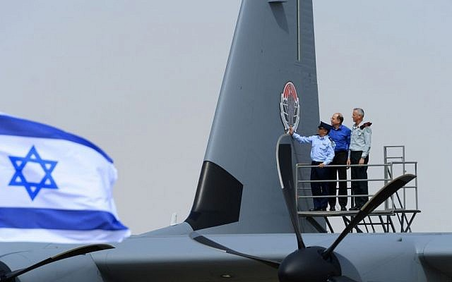 IDF chief Benny Gantz, right, and Defense Minister Moshe Ya'alon, center, along with another official, inspect the IAFs new Super Hercules aircraft, on April 9, 2014. (photo credit: courtesy IDF)