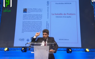A speaker at this week's UOIF conference in Paris, France (photo credit: YouTube screenshot)