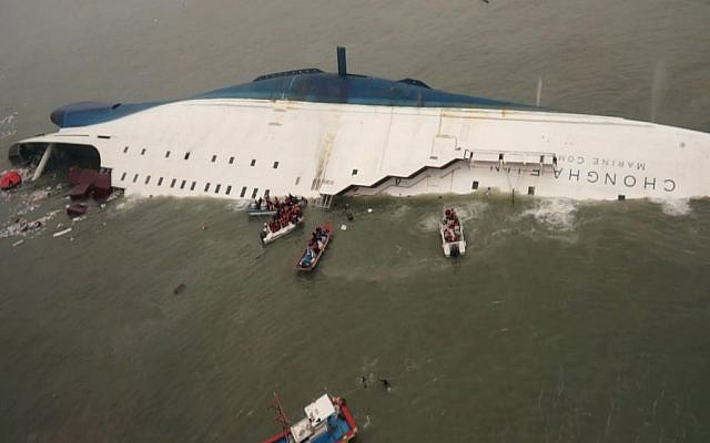 South Korean rescue team boats and fishing boats try to rescue passengers of a ferry sinking off South Korea's southern coast, south of Seoul, April 16, 2014. (photo credit: AP/South Korea Coast Guard via Yonhap)