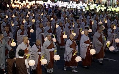 South Korean Buddhist monks carry lanterns in a parade for cherishing the memory of deceased persons and safe return of passengers aboard the sunken ferry boat Sewol on a street in Seoul, South Korea, Saturday, April 26, 2014. (photo credit: AP/Lee Jin-man)