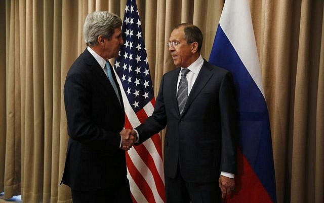 US Secretary of State John Kerry, left, shakes hands with Russian Foreign Minister Sergey Lavrov for a bilateral meeting to discuss the ongoing situation in Ukraine in Geneva Thursday, April 17, 2014 (photo credit: AP/Jim Bourg, Pool)