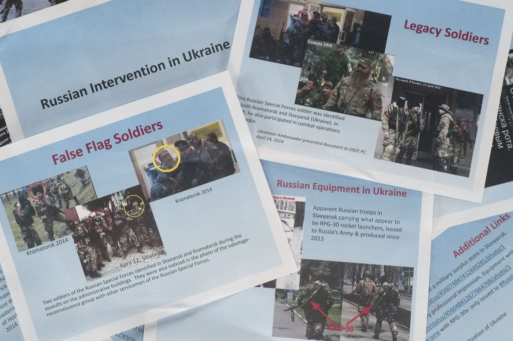 These printed copies of a presentation released by the US Department of State purport to show Russian involvement in eastern Ukraine. The 11-page document contains images of soldiers in eastern Ukraine that the State Department says are Russian forces, showing militants wearing similar uniforms and brandishing Russian weapons. There was no way to immediately verify the photographs, which the State Department says were taken from the Internet and social media. (photo credit: AP)