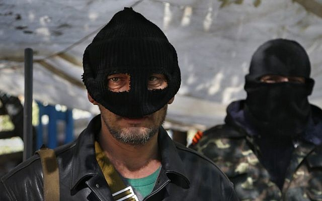 Masked pro-Russian militants stand guard at the barricades in Slavyansk, eastern Ukraine, Friday, April 25, 2014 (photo credit: AP/Sergei Grits)