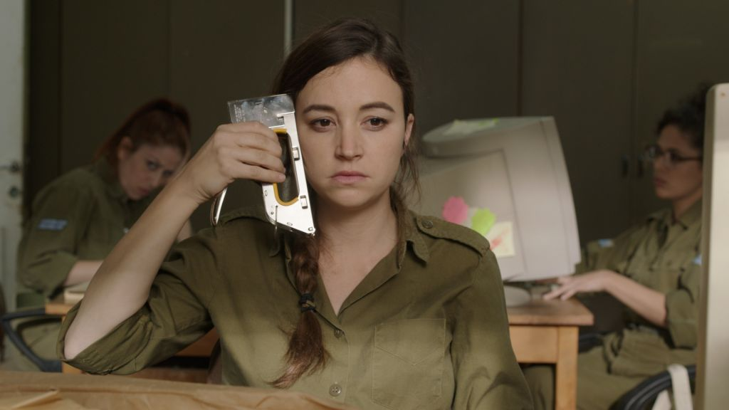 Nelly Tagar stars as Daffi, the Non-Commissioned Officer in Charge of Shredding in Talya Lavie's IDF comedy 'Zero Motivation' (courtesy: Match Factory)