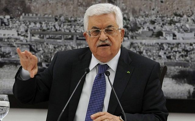 Palestinian Authority President Mahmoud Abbas meeting with journalists in Ramallah a day before his Fatah faction signed a reconciliation agreement with Hamas, April 22, 2014. (Palestinian Press Office via Getty Images/JTA/File)