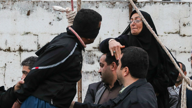 Balal Abdullah (L) and Abdollah Hosseinzadeh's mother, who decided to pardon her son's killer (photo credit: AFP/Arash Khamooshi/ISNA)