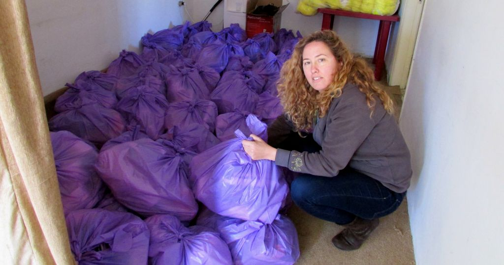 IsraAid volunteer Dana Manor with the bags of baby supplies ready for distribution. (photo credit: Debra Kamin/Times of israel)