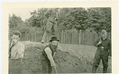 Jewish men rounded up for forced labor in Krakow, Poland (photo credit: Shem Olam Institute)