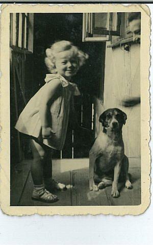 Janet Singer as little girl with her dog (courtesy Steve Maas)