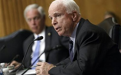 Senator John McCain, R-Arizona, on Capitol Hill in Washington, April 8, 2014 (photo credit: AP/J. Scott Applewhite)