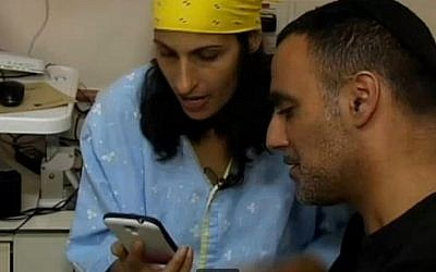 Miri Avrahami and her husband thank Lydia Labuschagne's brother Nick for agreeing to donate his sister's organs to Israeli patients in need. (photo credit: screen capture, Channel 2 News)